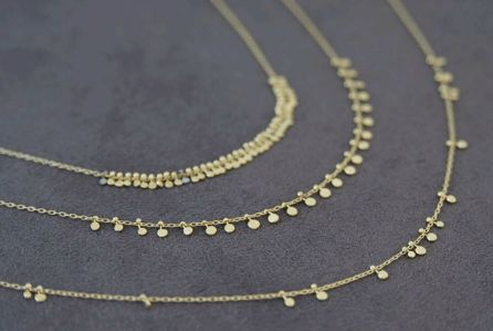 """Sia Taylor """"Grasses & Seeds"""" gold necklaces."""
