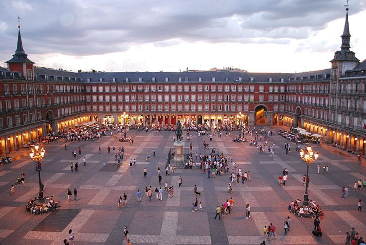 The Plaza Mayor has been the scene of multitudinous events: markets, bullfights, soccer games, and public executions. Now it has a ring of old and traditional shops and cafes under its porticoes. #Sights #Cafe