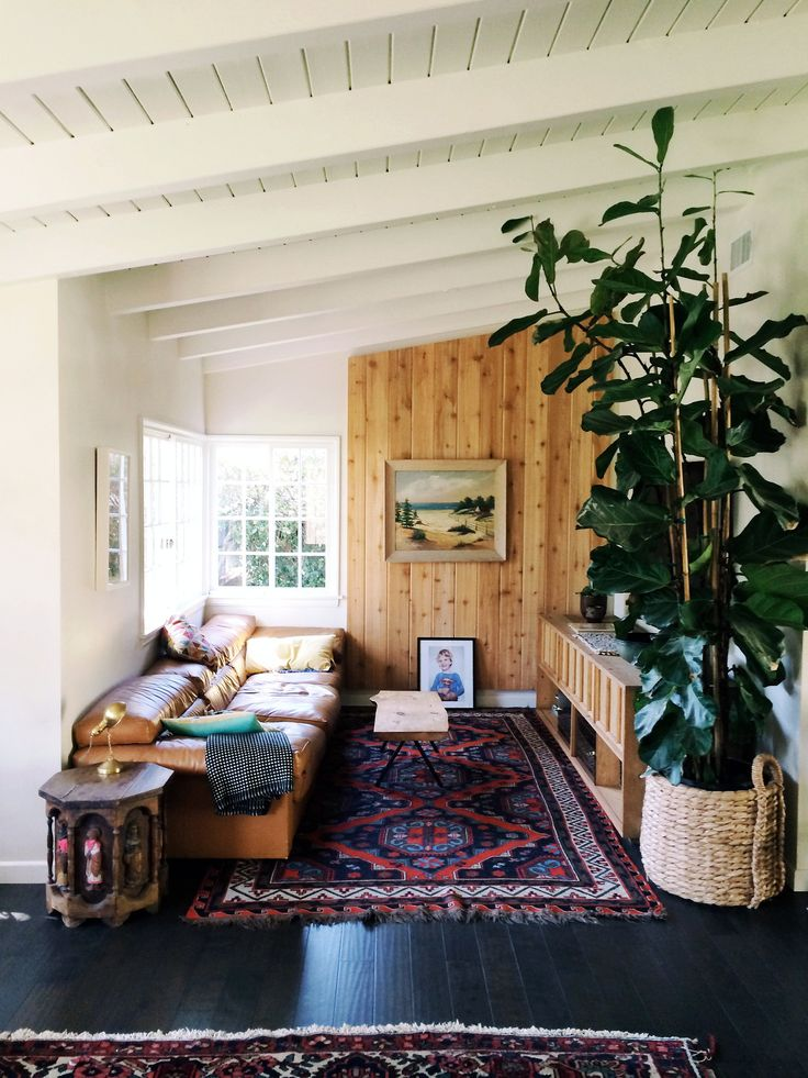 Boho living room with a planked ceiling, love the large vintage rug
