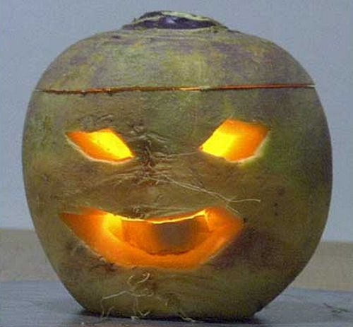 Jack o' Lanterns originated in Ireland where people placed candles in hollowed-out turnips to keep away spirits and ghosts on the Samhain holiday.: