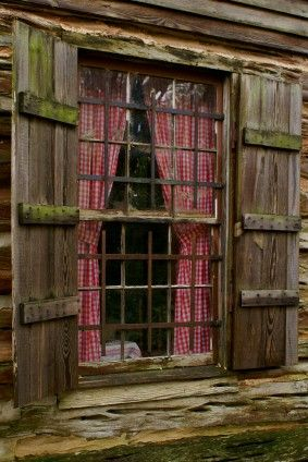 Log Cabin Window with Old Fashioned Shutters and Red and White Checkered Curtains