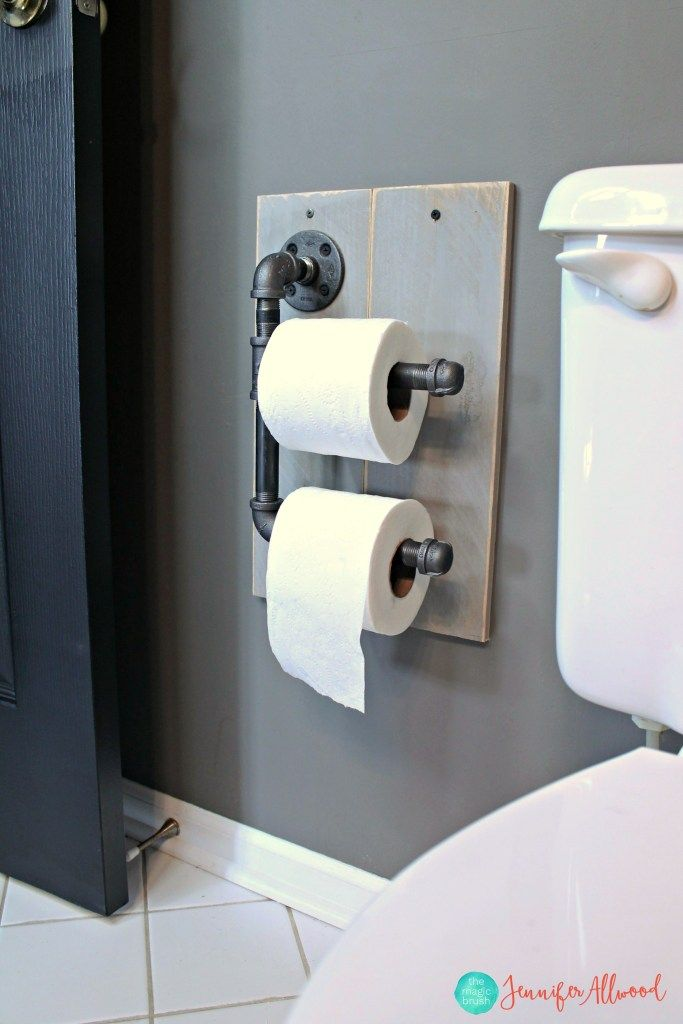Industrial toilet paper holder from pipes, by Jennifer Allwood of The Magic Brush, featured on Funky Junk Interiors