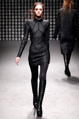"Gareth Pugh *more of what everyone will be wearing in about 600 years. They call 'em ""planetary cycles"" after the Great Collapse. This is allowing for previous fashion trends to come full-circle many times over, of course.*"