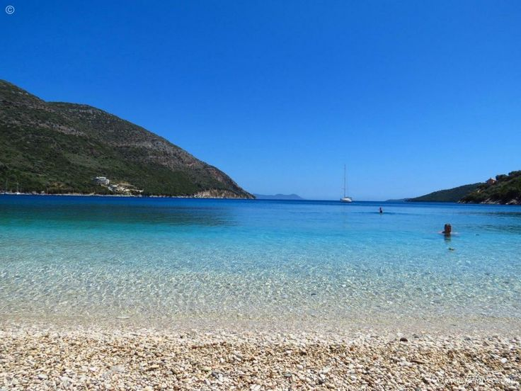 Swimming in a mirror at Poros (Mikros Gialos) - pebbled beach with clear and calm waters, Lefkada
