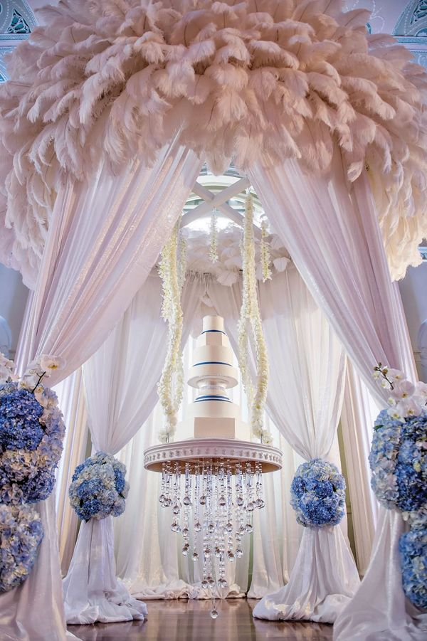 blue and silver reception wedding cake table feathers reception draping