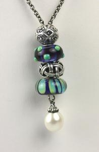 Fantasy Pearl necklace by Troll beads.  Add as many glass or sterling beads as you please.