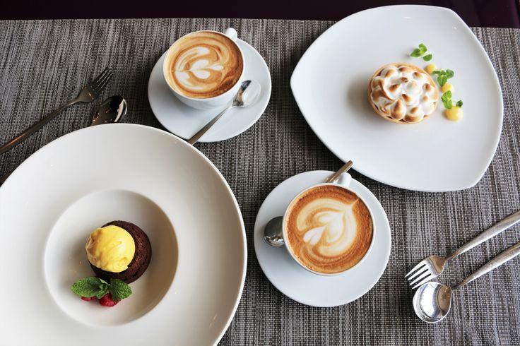 Lemon curd tartlet with Italian meringue and chocolate fondant from our Á la carte dessert menu.