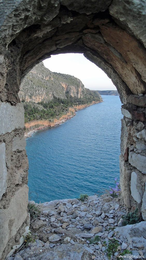 View of the the trail leading from #Arvanitia to #Karathona beach in #Nafplio, from #Akronafplia Castle, #Peloponnese, #Greece