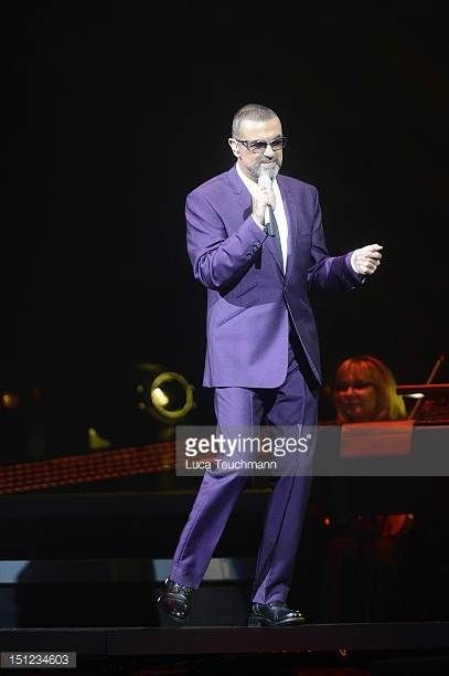 George Michael performs on stage during his 'Symphonica' tour at town hall on September 4 2012 in Vienna Austria