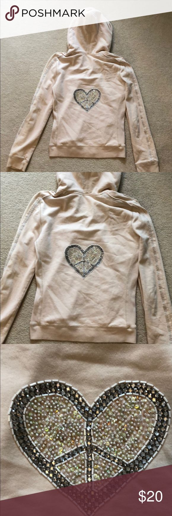 Twisted Heart embellished peace/heart hoodie L Size L tan/nude colored zip up Twisted Heart hoodie. Back size is embellished with peace sign heart. Small little pin hole notes in picture, otherwise in good condition! Tops Sweatshirts & Hoodies
