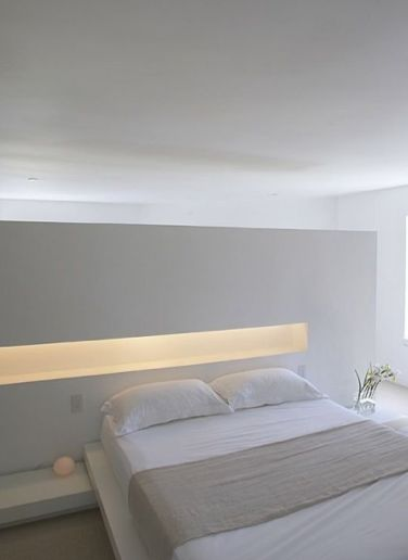 Beautiful indirect lighting in this white and pure bedroom inside the residential Lymm Water Tower by Ellis Williams Architects.