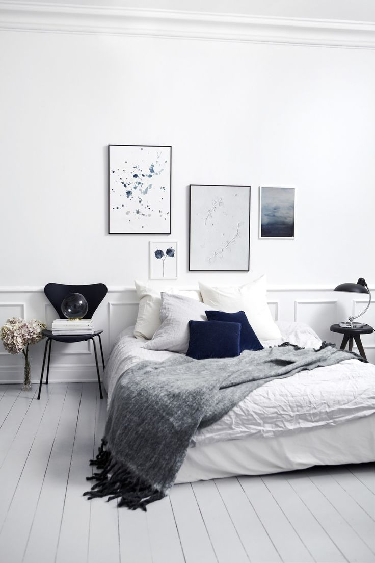 Calm Nordic bedroom in stormy shades of blue and grey. Wall art is by Danish artist Trine Holbæks.