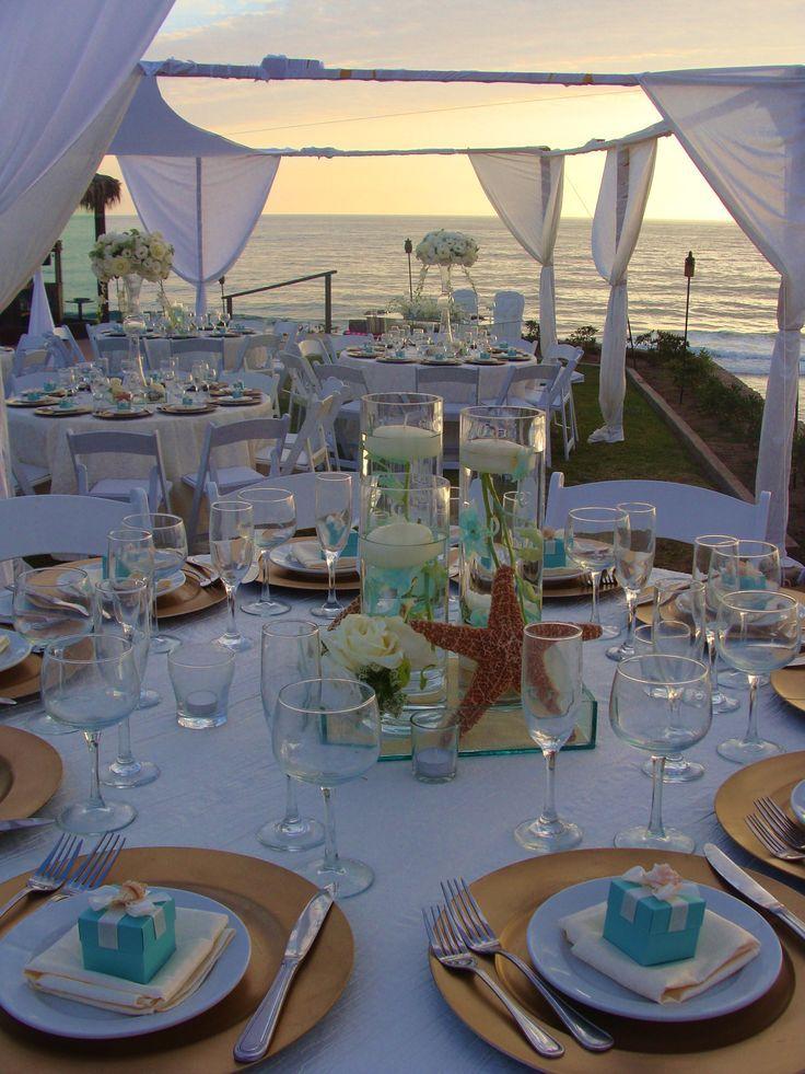 Centros de mesa en cristal con flores y velas