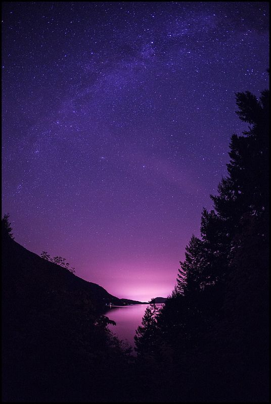 Sproat Lake Milky Way Just a few minutes out of Port Alberni the light fades and the Milky Way comes out to play. The lack of light pollution in the Alberni Valley makes it a great place to shoot stars, particularly once the moon has set. This photo looks east over Sproat Lake towards the lights of town. #HeartOfVancouverIsland #HOVI #PortAlberni #AlberniValley #SproatLake #MilkyWay #ExploreBC #WegoCananda #Canada #VancouverIsland