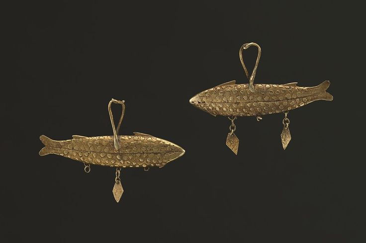 Fish Earrings 11558  Sumba Gold 19th/early 20th Century 2.5 in /6.3 cm - 12.6 and 12.1 gr  A very rare and well used pair of earrings that feature fish, a subject that also shows up as a motif in early Sumba chief's wraps called hinggi.