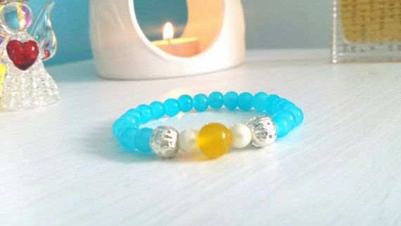Made with genuine yellow jade and blue fluorite gemstones. Silver spacer beads and pearl gemstones. Spiritual prayer mala yoga bracelet very rare. View our shop for more info