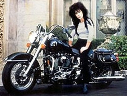 Cher made motorcycle history on July 16, 2003, along with an infamous group of celebrities including Peter Fonda, Sylvester Stallone, Arnold Schwarzenegger and Hulk Hogan as they rode to the steps of New York's City Hall where the mayor proclaimed the third Wednesday in July as Ride To Work Day. She has a 1994 black Harley Davidson Fatboy!