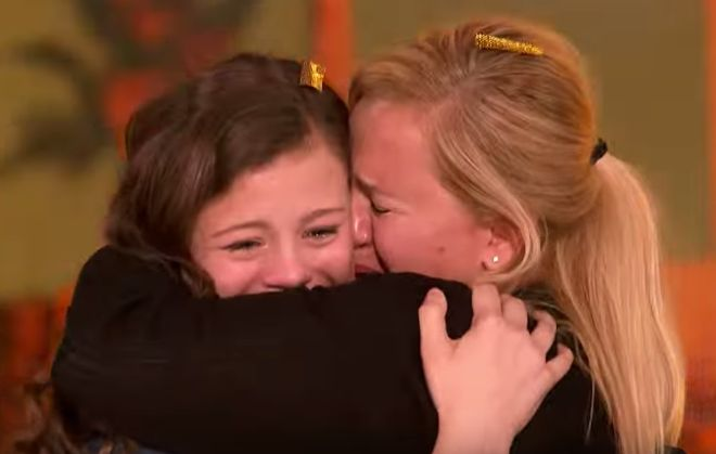 """Thirteen-year-old singer Angelina Green earned the last Golden Buzzer on America's Got Talent Season 12! In an episode aired Tuesday, July 11, Green received the Golden Buzzer from German-American supermodel Heidi Klum after performing her """"I'll Stand By You,"""" a song popularized by The Pretenders in 1994. Also Watch: America's Got Talent Season 12 July 11 Auditions Episode Green was emotional as soon as she took the stage, she confessed, """"I'm dedicating this song to my mom because she's…"""