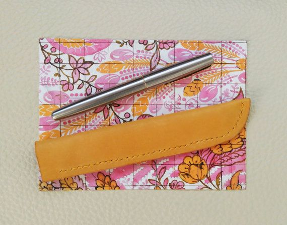 £14.50 A sleek luxury leather pen case, made of soft and supple leather in a sunshine yellow. Inspired by a 1688 design by James Leman (England) for woven silk. The design is on the postcard pictured, which comes as a free gift with the pen cover.  https://www.etsy.com/uk/listing/482077300/luxury-leather-pen-cover-in-yellow-hand?ref=listing-shop-header-1  Luxury Leather Pen Cover in Yellow. Hand stitched, Stationary, Pen Case, Christmas, Gift for Her, Handcrafted, Art Deco, Stocking Filler.