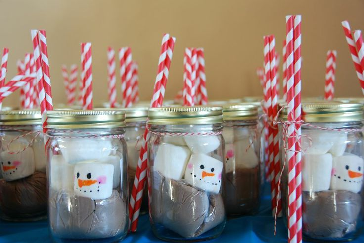 Winter Wonderland first birthday party favors. Mason jars, painted on marshmallows, hot chocolate and red and white striped paper straws. OLAF Frozen party melted snowman