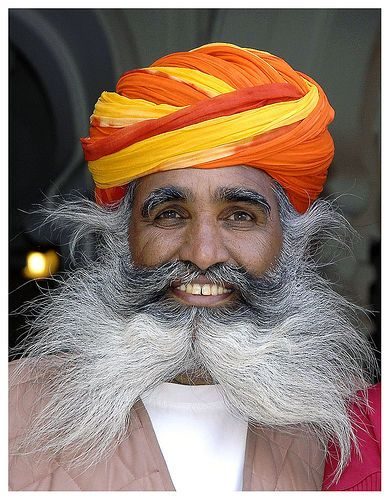 Bright eyes and a warm smile ... Hookah man photographed in Jodhpur, India   © Mario Lapid