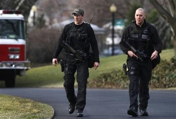 Secret Service Emergency Response Team officers patrol the South Lawn of the White House prior to President Barack Obama leaving, Friday, March 6, 2009, for a day trip to Columbus, Ohio.