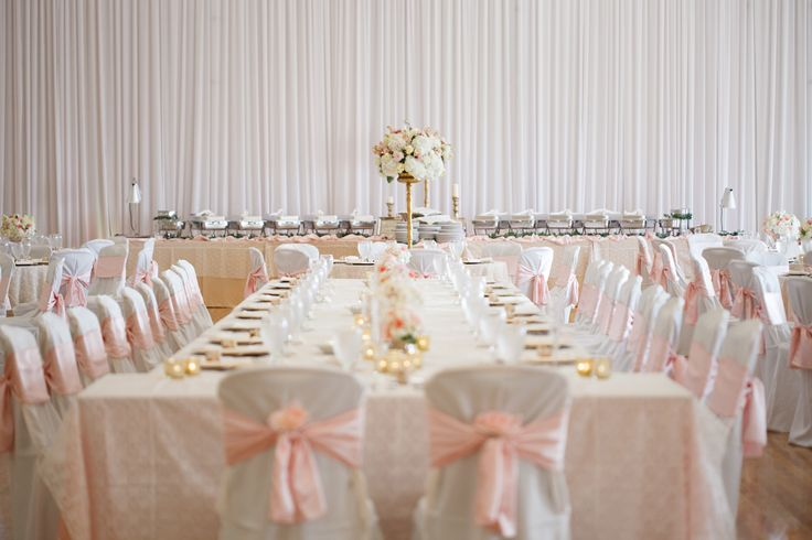Beautiful blushing wedding at The Regent, Brandon FL. Catering and set up by Affordable Catering. Linen provided by Connie Duglin. Flowers done by Tampa Wedding Studio.