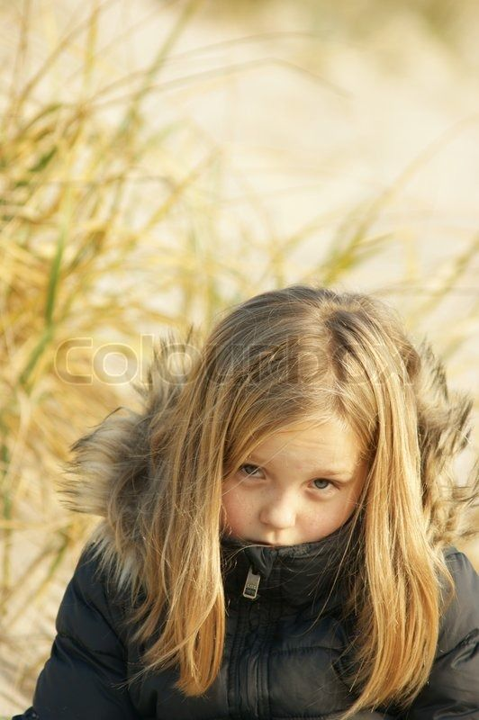 Autumn girl looking angry into camera stock photo on Colourbox