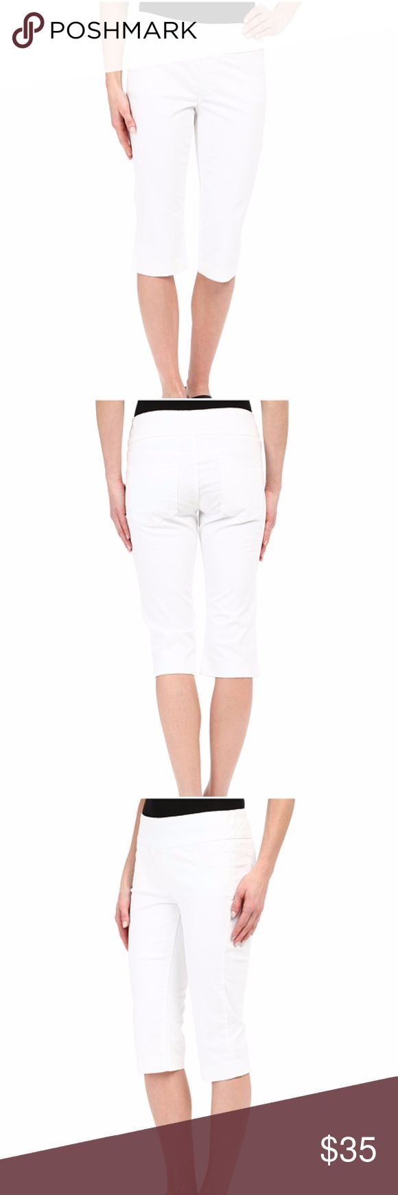 """Miraclebody Jeans Rudy 17"""" Cuffed Sateen Shorts Look 10 lbs. lighter in 10 seconds in a Miraclebody® short. Pull-on short features a fitted leg with cuffed opening. Hand-crafted canvas Miracle panel holds in the tummy for a trim silhouette. Soft and stretchy sateen fabric. Higher rise hits at the navel. Back pockets. Faux front pockets. 98% cotton, 2% spandex. Machine wash cold, tumble dry low. Imported. Measurements: Outseam: 25 in Inseam: 17 in Front Rise: 9 in Back Rise: 14 in Leg…"""
