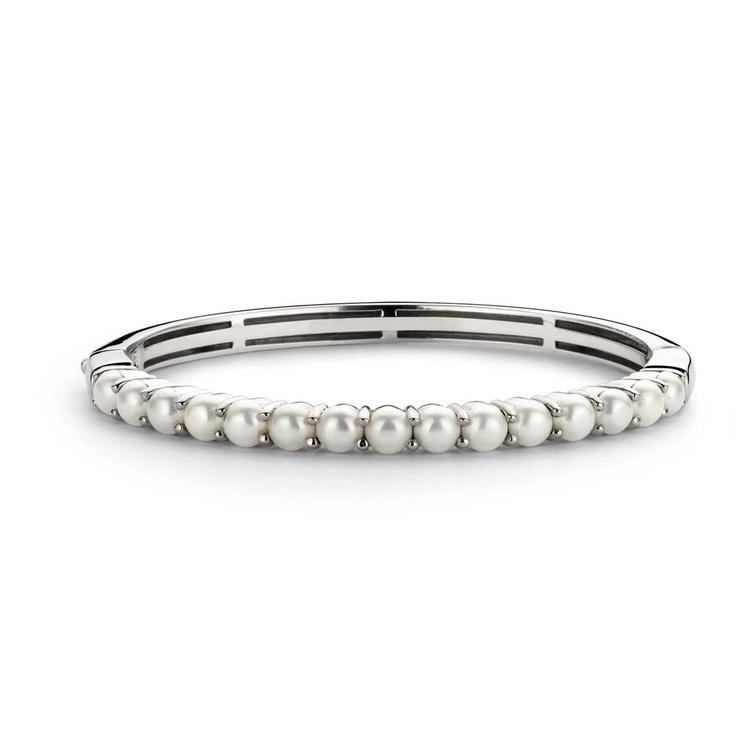Armbånd med hvite perler , Ti Sento