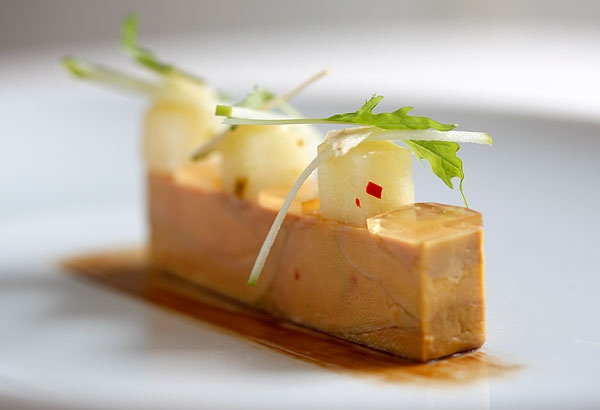 Pressed terrine of duck liver foie gras, apple jelly and chutney available from The Vineyard at Stockcross, Newbury, Berkshire, UK.
