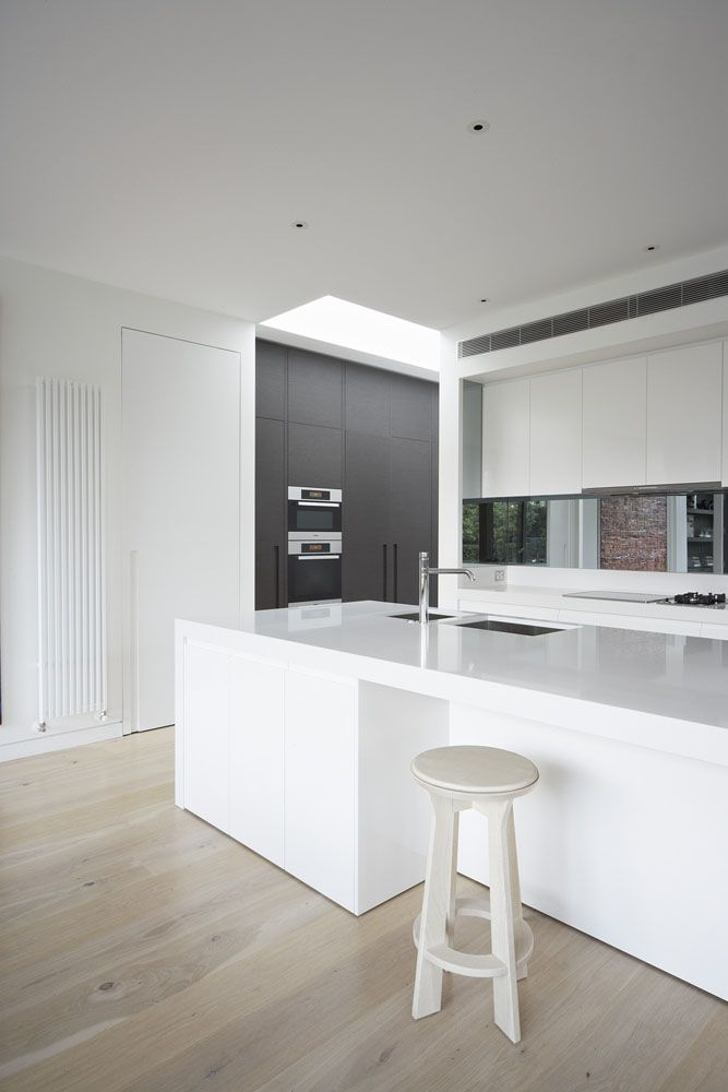 We're loving the clean white stone on wooden floors - stunning!  Caesarstone Snow Kitchen by MIM Design