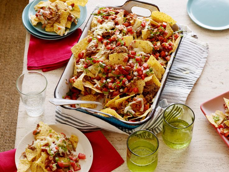 Cowboy Nachos     : A marinated beef brisket is the basis for quite of few of Ree Drummond's favorite meals. Use it to top broiled layers of tortilla chips with spicy beans, cheese and pico de gallo. The whole thing gets broiled until the cheese melts and then all you have to do is dig in.
