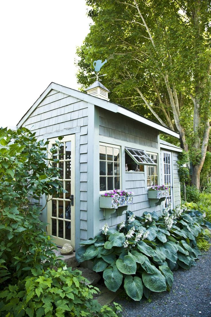 A shingled shed is topped with a watering-can weather vane that homeowner Hanken made.