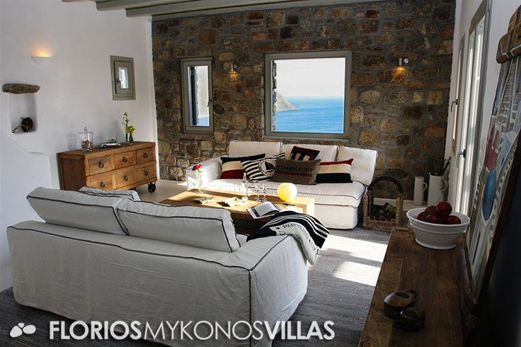 The villa's charming interior, is a combination of minimal architecture with beach house elements. A fully equipped open-plan kitchen with modern appliances, gives onto a living-sitting space directly accessing the water-front swimming pool and its wide terraces. FMV1482 Villa for Rent on Mykonos island, Greece. http://florios-mykonos-villas.com/property/fmv1482/