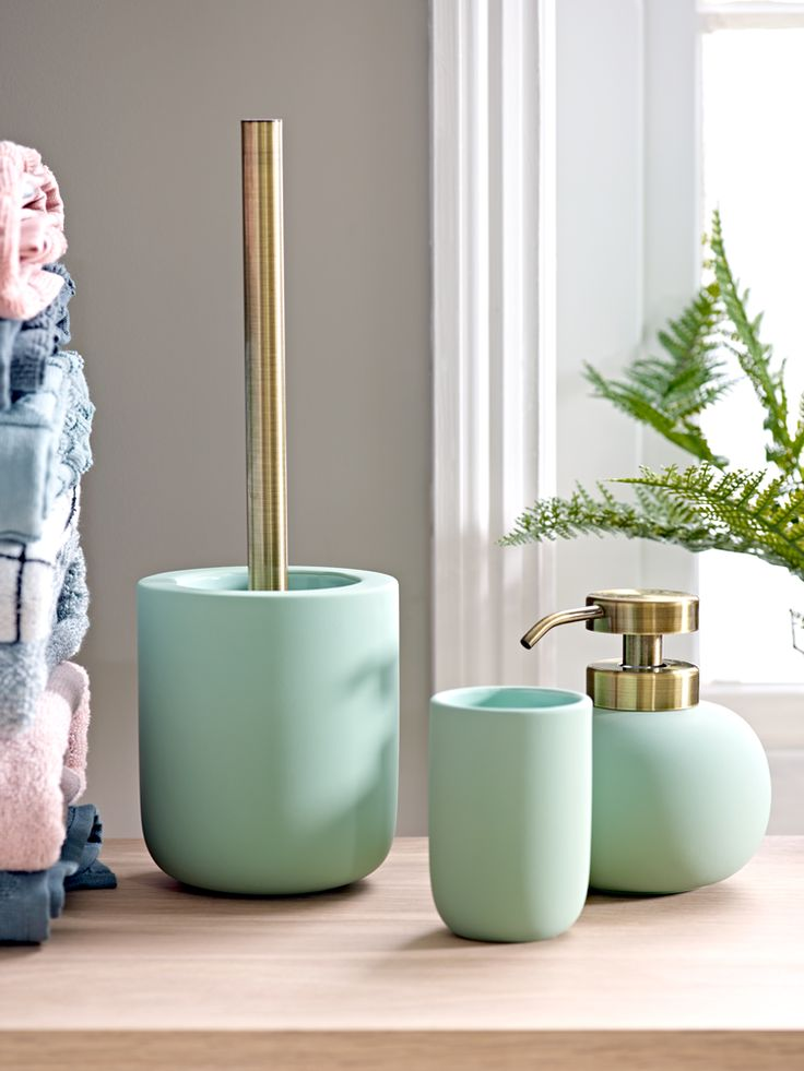Crafted from ceramic in with a beautiful, soft rubber finish and brass attachments, our collection of eau de nil bathroom accessories makes the perfect pastel colour accent for a white or industrial style bathroom. Display as a matching set, or purchase individually and pair with our Glass Accessories - Grey for an eclectic, mixed colour and texture look.  Also available in blush.