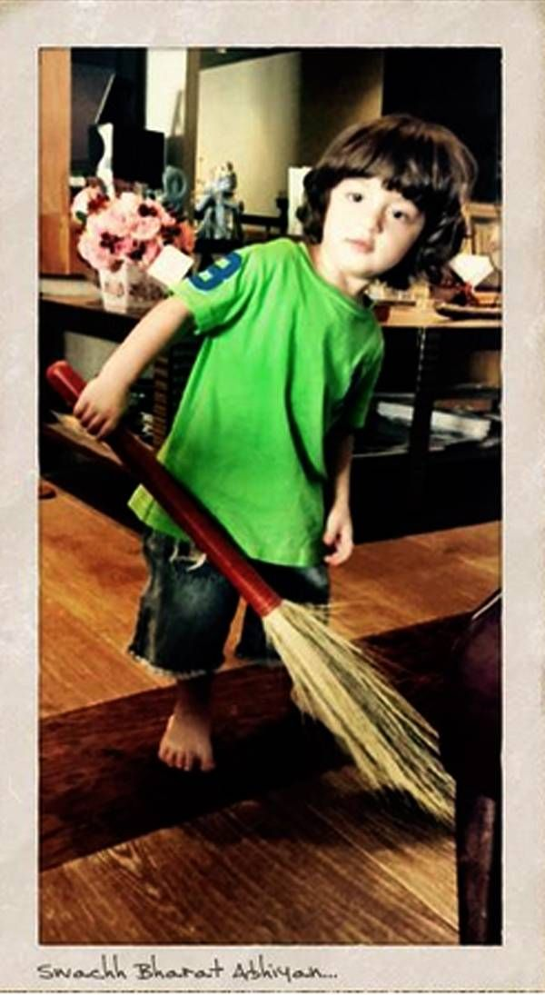 "After being known as a book lover, Shah Rukh Khan's son AbRam has apparently taken to cleaning! Tweeting a picture of the tiny tot holding a broomstick, Shah Rukh wrote, ""Starting him young to believe in Clean India….Green India…& maybe a round or two of Quidditch!!"" [sic] Cleanliness freak or a fan of Hogwarts, little AbRam is a celebrity already. (Image courtesy: Shah Rukh Khan's Twitter account)Read further to know about Isha Koppikar's new commercial with her eight-month-old daughter..."