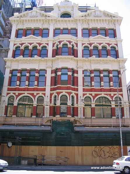 What a little gem - Mutual House at 263 Flinders Street opposite Flinder Street Station. This building have undergone a loving restoration .  Its red brick surface has been sandblasting into the millenium trimmed in whipped sugar cream.  Brittania sits boldly on the top most of the facade.  When a restoration is done right its a beautiful thing