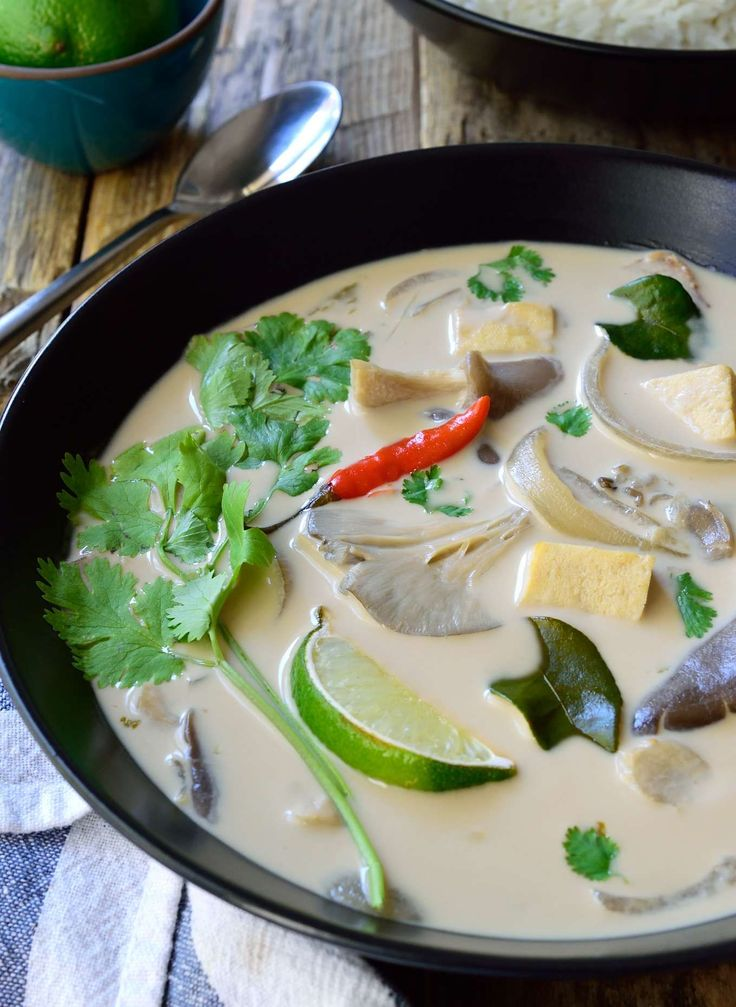 This vegan Thai coconut soup is a light and tasty, totally vegetarian version of Tom Kha Gai. This vegan soup is super simple and ready is just 15 minutes!
