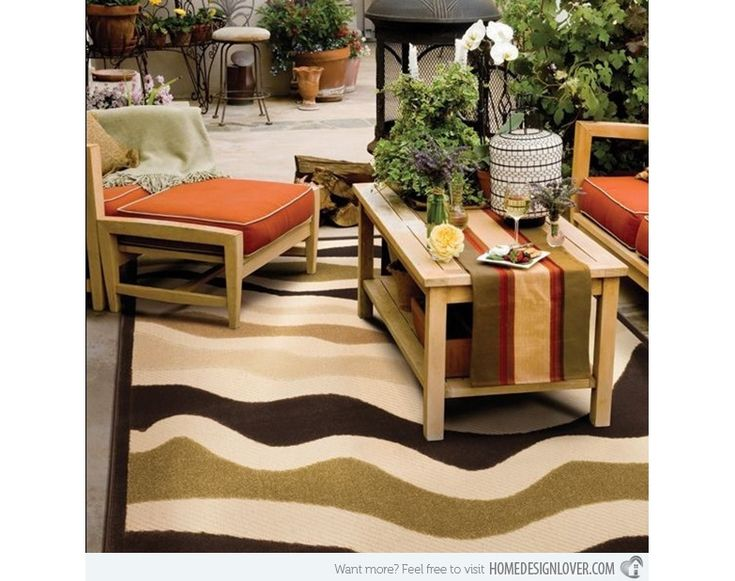 Outdoor Patio Space With Wavy Patterned Area Rug