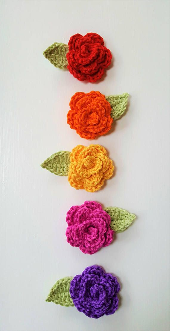 1pc Crochet Rose with leaf, crocheted by hand in 100% cotton yarn.  Roses that are ready-to-ship are available in: Red, Orange, Purple, Fuchsia Pink, Yellow. Other colours are available to order.  Size: Rose 5cm/1.75in wide, incl leaf 7cm/2.75in, 1.5cm/0.4in high.  These little flowers are ideal to embellish a wide array of items: hair bands or hairclips, brooches, sewing projects, scrapbooking, cardmaking, etc.  Thanks for stopping by! R♥