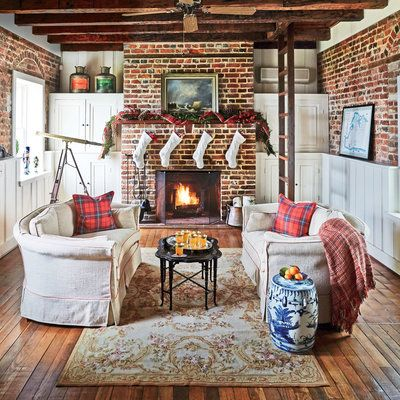A former customs house on the Chesapeake Bay gets a holiday spin, thanks to pops of bright red in the plaid throw and pillows and the family's nutcracker collection displayed in the window.
