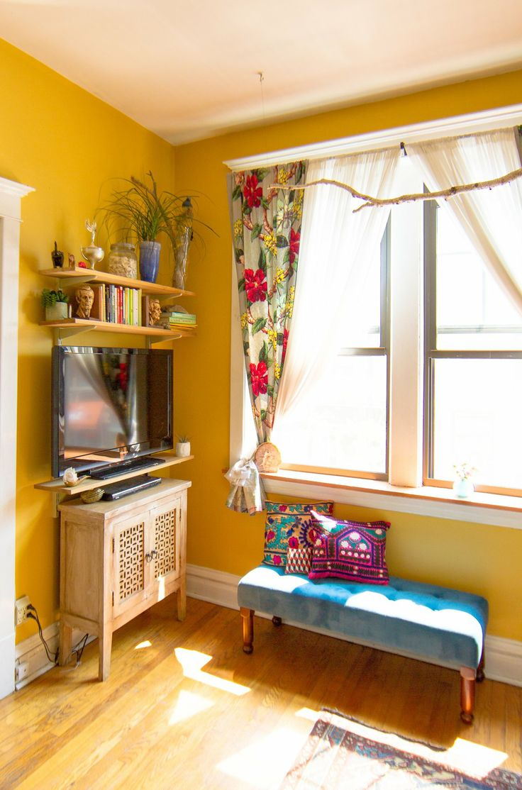 TV space with book shelves above. Good idea, takes the focus away from the TV. Amy's Vintage Jewel Tone Apartment from Apartment Therapy.