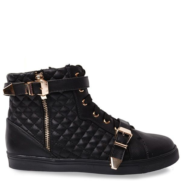 Black sneaker with quilted and gold details, gold decorative zipper and two straps.