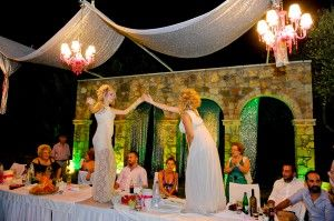 Fun image of Mother and Godmother dancing on the christening table - Location Ktima Tritsimpida Greece - Summer Night - Photography Con Tsioukis - ICON PHOTOGRAPHY MELBOURNE - www.iconphotos.com.au