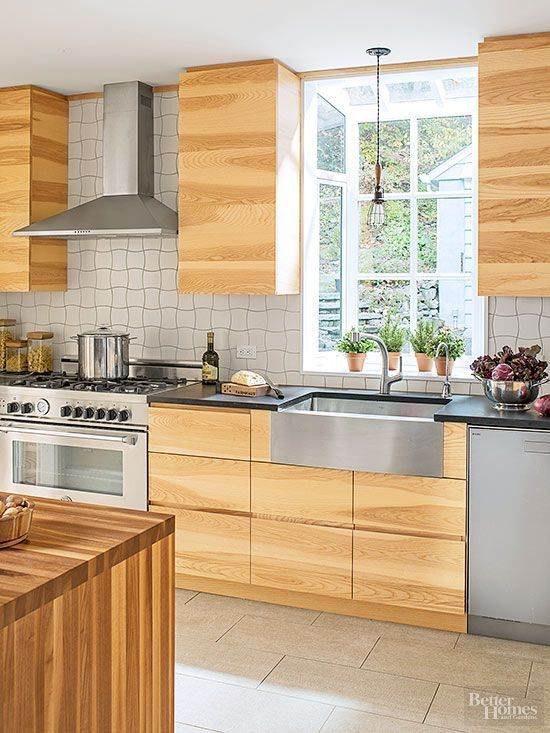 Paint, wallpaper, peel-and-stick wood products: All are great options to give a new face to cabinets. Think about adding unusual pattern or color, or even removing doors on some upper cabinets.