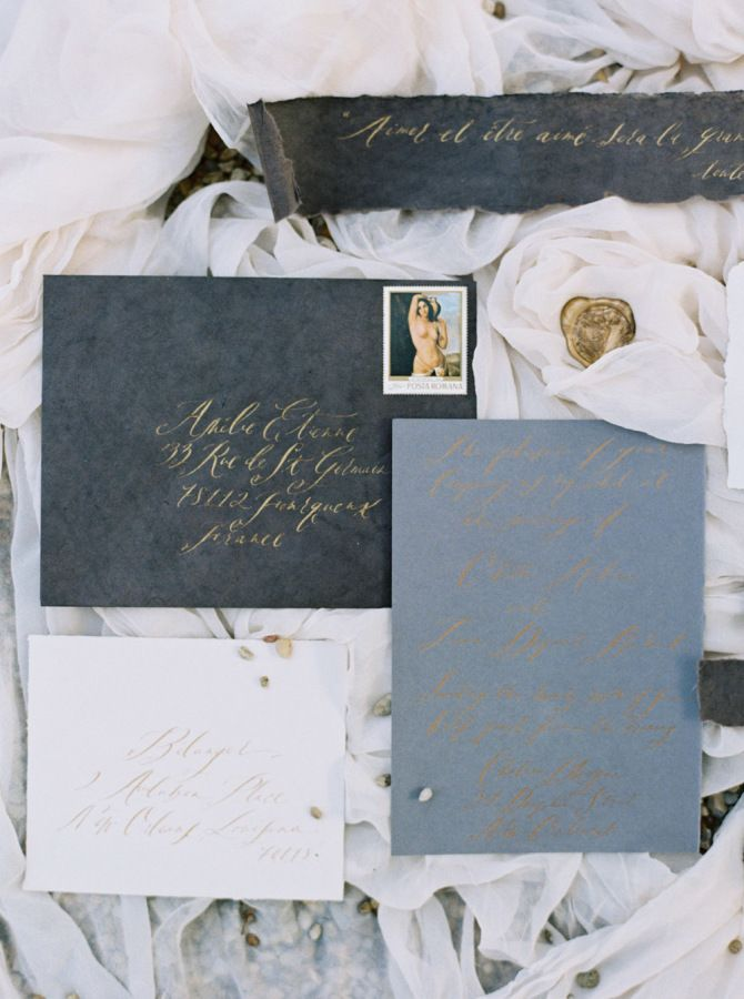 Vintage black, slate blue and gold hand-calligraphed wedding paper suite: http://www.stylemepretty.com/louisiana-weddings/new-orleans/2016/09/22/meet-mysterieuse-dame/ Photography: Katie Grant - http://www.katiegrantphoto.com/