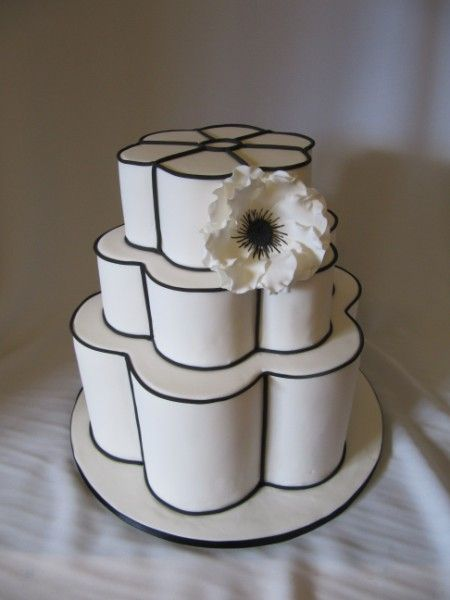 Striking white and black flower cake! Make it out of toilet paper for funny house warming gift Visit http://www.brides-book.com for more great wedding resources
