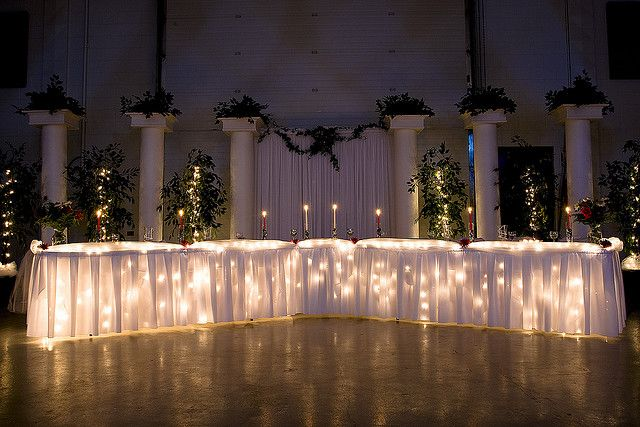 Lights under Head Table, Cake Table, and Gift Table <3  Love the set up of the front table too!