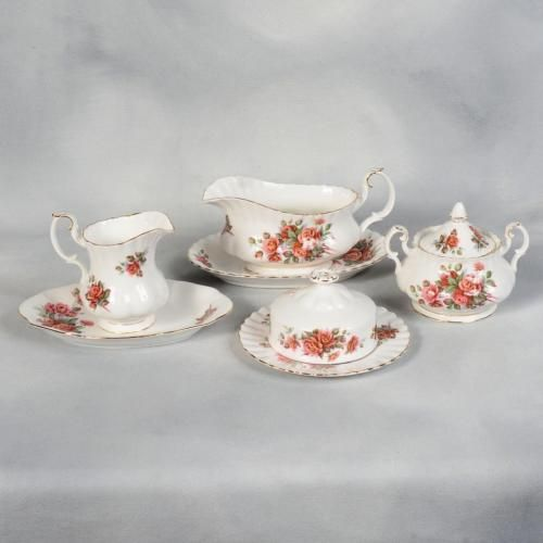 "Royal Albert Centennial Rose Serving Pieces Set. Gravy Boat: 3-7/8"" x 3¼"" high, Underplate: 8-7/16"" x 5-5/8"". Creamer: 4½"" x 3-3/4"" high. Sugar w/Lid: 5½"" x 4½"" high. Oval Tray: 8-1/8"" x 5¼"". Covered Butter Dish: Plate: 6-5/16"" Lid: 4"" diam x 2-3/4"" high. C $124.99 (approx $89.91 US)/8-pc Set at secondchance13 on ebay, 2/14/16"